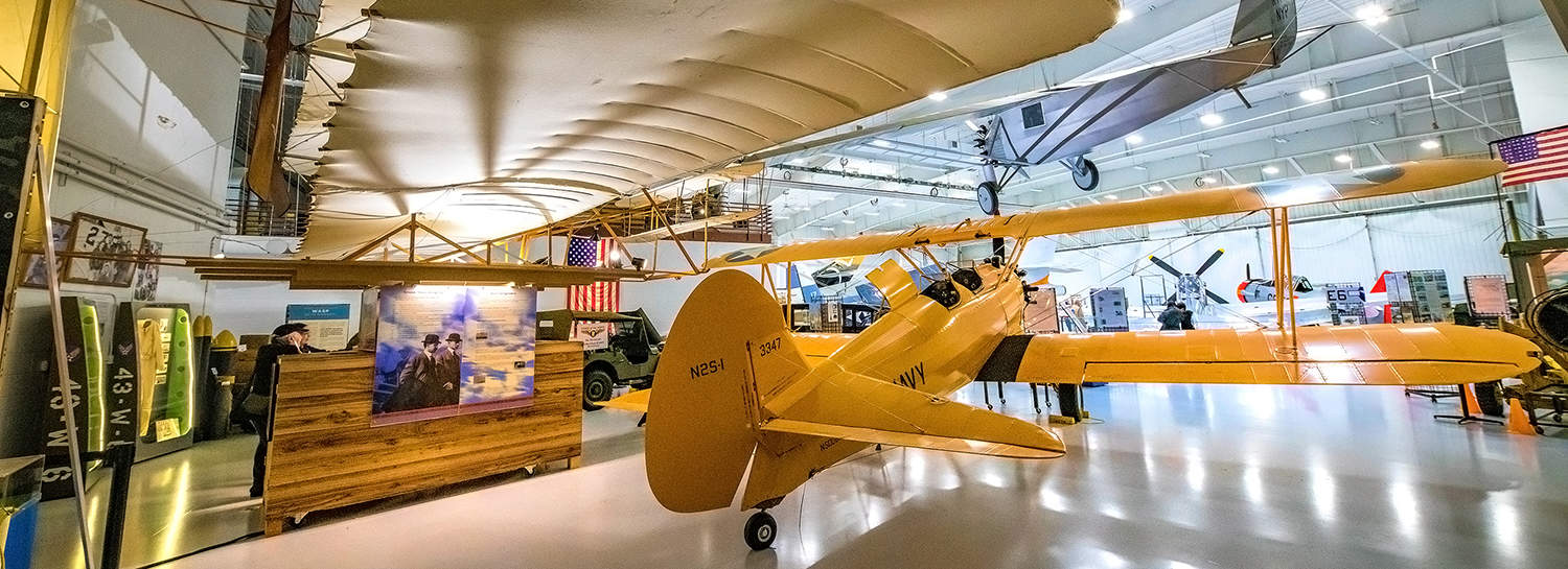 Wings Of The North Museum. Wright Flyer, Stearman, Spirit Of St. Louis airplanes are in this photo.